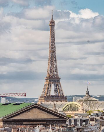 Eiffel Tower in Paris on a cloudy day 스톡 콘텐츠