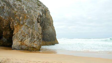 Wild Atlantic ocean coast at Adraga Beach in Portugal - travel photography Stok Fotoğraf - 133444207