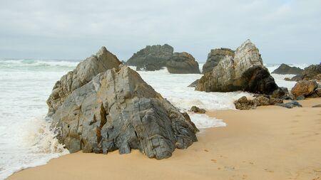 Wild Atlantic ocean coast at Adraga Beach in Portugal - travel photography Stok Fotoğraf - 133444232
