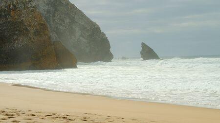 Wild Atlantic ocean coast at Adraga Beach in Portugal - travel photography Stok Fotoğraf - 133477127