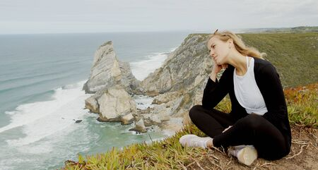 Sitting at the coast of Cabo da Roca in Portugal 版權商用圖片