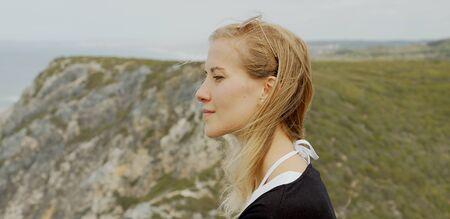 Young traveler at Cabo Da Roca in Portugal at the Atlantic Ocean
