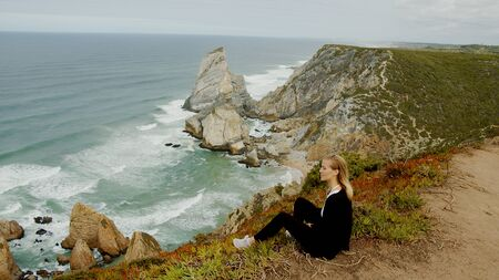 Sitting at the coast of Cabo da Roca in Portugal 版權商用圖片