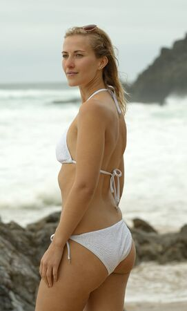 Young and sexy woman at the beach