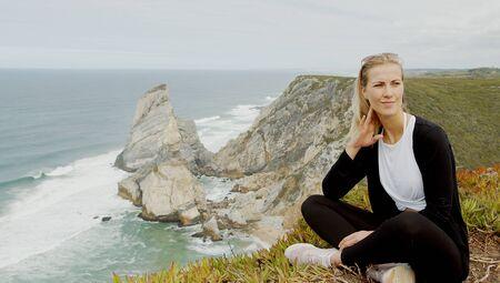 Sitting at the coast of Cabo da Roca in Portugal Stok Fotoğraf