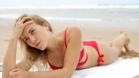 Sexy girl poses for the camera - happy girl on summer vacation at the beach