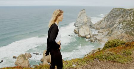 Beautiful woman relaxes at Cabo da Roca in Portugal - Sintra Natural Park Stok Fotoğraf