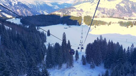 Ride in a cable car in the Alps on a winters day