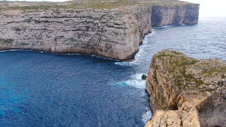 The remains of Azure Window at Dwerja Bay at the coast of Gozo Malta