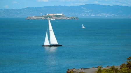 Saling boat in the San Francisco Bay with a view over Alcatraz - travel photography Stock Photo