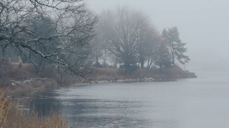 Small lake in the mist on a foggy day - travel photography