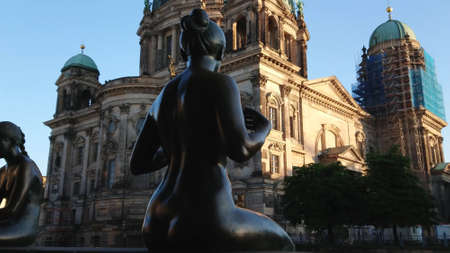 Bronze statues at River Spree in Berlin at Berlin Cathedral - CITY OF BERLIN, GERMANY - MAY 21, 2018