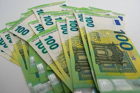 Big amount of money - 100 Euro bills on a white background