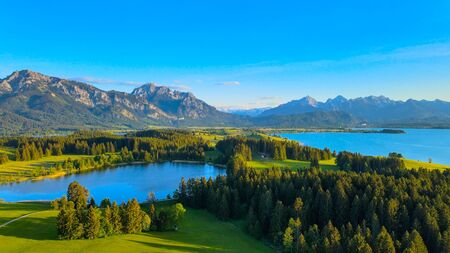 Aerial view over Lake Forggensee at the city of Fuessen in Germany