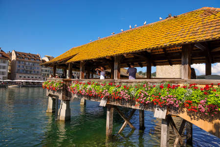 Chapel Bridge in the city of Lucerne - LUCERNE, SWITZERLAND - AUGUST 16, 2020
