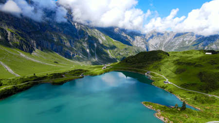 Flight over a wonderful mountain lake in the Swiss Alps - Lake Truebsee on Mount Titlis