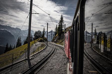 Cog railway train tracks in the Swiss Alps - COUNTY OF BERN. SWITZERLAND - OCTOBER 9, 2020