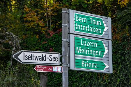 Direction signs to Bern Thun and Interlaken in Switzerland - COUNTY OF BERN. SWITZERLAND - OCTOBER 9, 2020