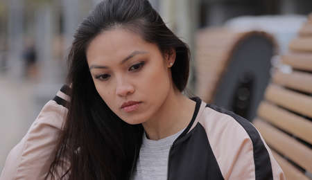 Young Asian woman in a city