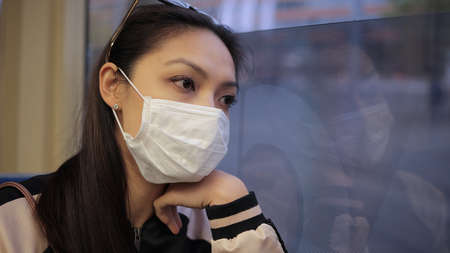 Wearing a face mask while driving in a tram