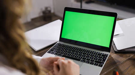 Laptop with green screen display close up shot