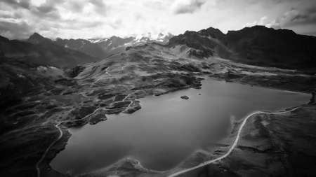 Wonderful Mountain Lake in the Swiss Alps - aerial view in black and white Stock Photo