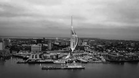 Harbour of Portsmouth England with famous Spinnaker Tower - aerial view in black and white Foto de archivo