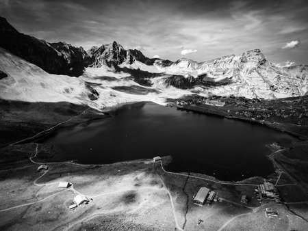 Beautiful Melchsee mountain lake in the Swiss Alps in black and white