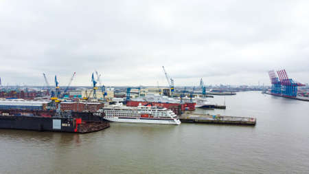 Port of Hamburg from above on a cloudy day - CITY OF HAMBURG, GERMANY - DECEMBER 25, 2020