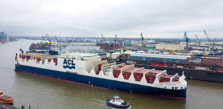 Huge container vessel in the harbour of Hamburg Germany - CITY OF HAMBURG, GERMANY - DECEMBER 25, 2020