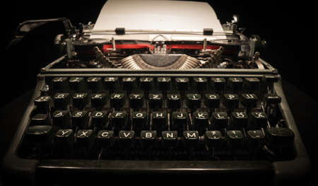 Writing a letter on an old typewriter - very nostalgic Stock Photo