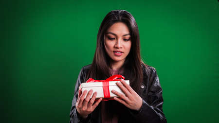 Young woman holding a gift box in her hands