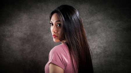Pretty Asian woman in the photo studio Standard-Bild