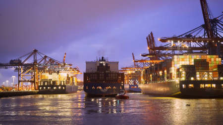 Port of Hamburg Container Terminal by night - Timelapse shot - HAMBURG, GERMANY - MAY 11, 2021 Editoriali