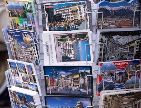 Postcards from Innsbruck AUSTRIA, EUROPE - souvenir shop - INNSBRUCK, AUSTRIA, EUROPE - JULY 29, 2021