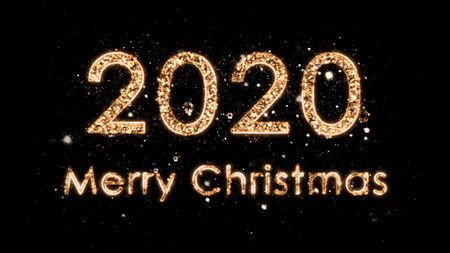 4k Christmas composition with congratulations 2020 and Merry Christmas. The numbers come from the magic sparks of the fireworks. Composition on a black background.