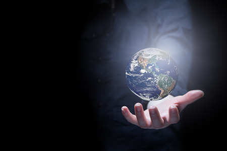 earth core: Hand of businessman holding earth planet. Stock Photo
