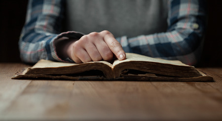 quiet adult: Woman hands reading the bible Stock Photo