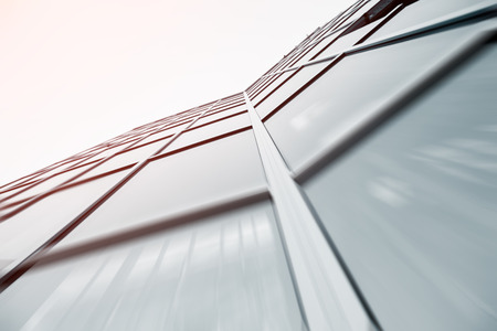 steel building: Wide angle abstract background view of steel light blue high rise commercial building skyscraper made of glass exterior. concept of successful industrial architecture and office center building Stock Photo