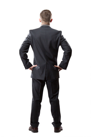 men standing: Portrait of successful businessman. Isolated on white. Back view