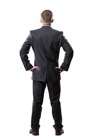 hombres trabajando: Retrato de hombre de negocios exitoso. Aislado en blanco. Vista trasera