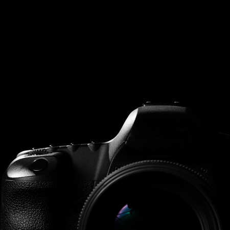 eos: Digital image of a professional modern DSLR camera low key image. Modern DSLR camera with a very wide aperture lens on with highlights and shadows in square shape