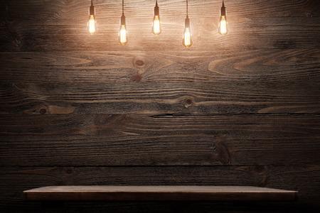 Wood shelf grunge industrial interior with edison light bulb