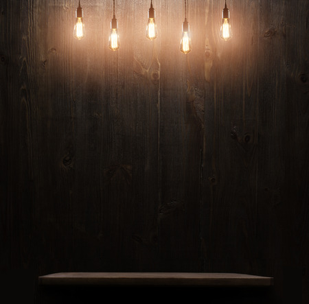 dark wooden background texture.wall with shelf and edison light bulb