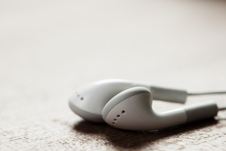 music background: concept of digital music white Headphones isolated