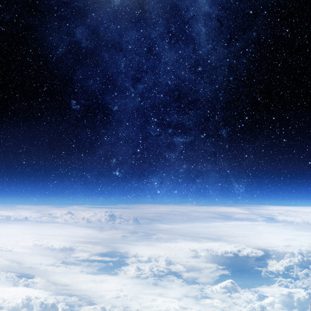 triangulum: Clouds of Earth planet and star sky on the background.
