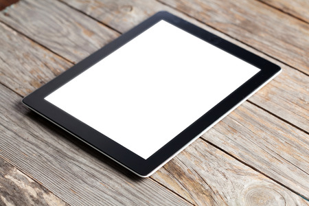 tablet devices: image os a black digital tablet computer with isolated screen on old wooden desk Stock Photo