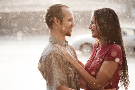 Love in the rain. Boy and a girl kissing in the rain