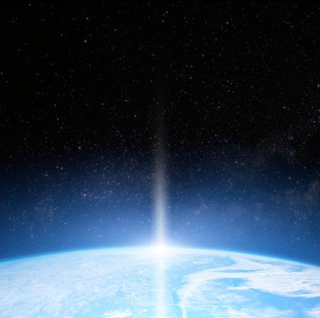 earth: Sun over Earth planet. Stock Photo