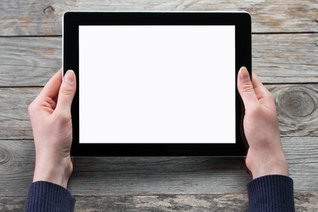 female hands hold digital tablet computer with isolated screen